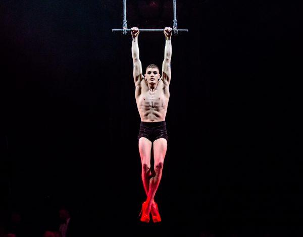 Jarred Dewey's electrifying trapeze performance. Photo by Bryony Jackson.