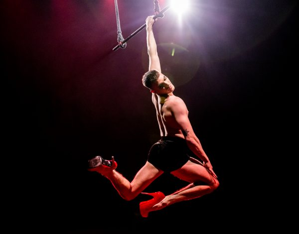 Jarred Dewey hanging from the trapeze. Photo by Bryony Jackson.