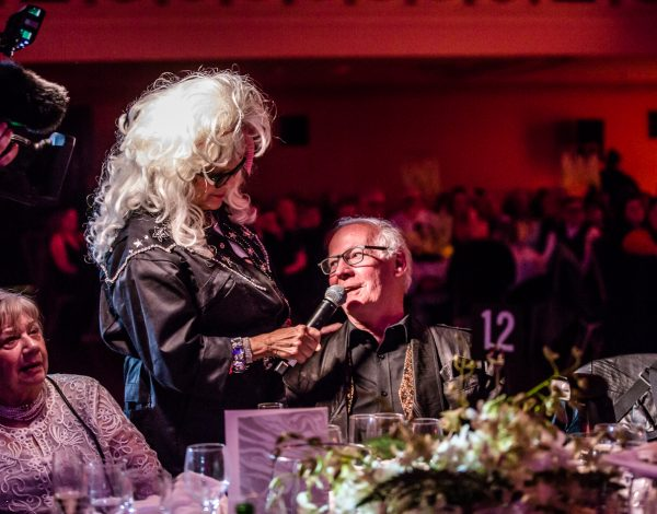 Tammy Whynot interviews guests at The Coming Back Out Ball. Photo by Bryony Jackson.